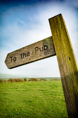 To the pub sign in rural English setting