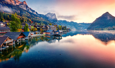 Autocollant pour porte Europe de l Est View from flying drone. Awesome sunrise on Grundlsee lake. Breathtaking morning view of Eastern Alps, Liezen District of Styria, Austria, Europe. Aerial cityscape of Grundlsee village.