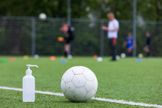 Bottle of disinfectant gel on a football field as one of the new measures against the corona virus