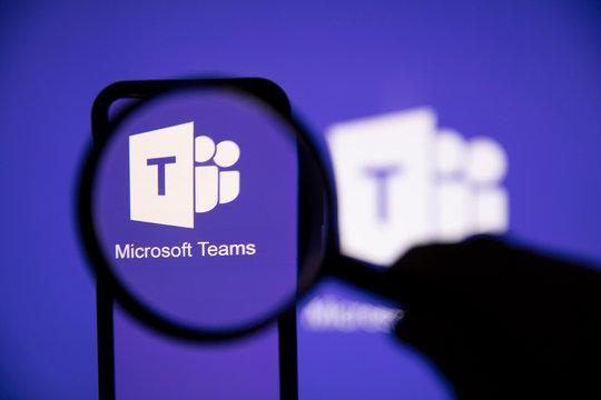 LONDON, UK - May 1st 2020: Microsoft teams logo under a magnifying glass
