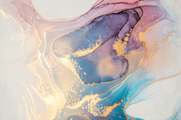 Luxury abstract fluid art painting in alcohol ink technique, mixture of blue and purple paints.  Imitation of marble stone cut, glowing golden veins. Tender and dreamy design.
