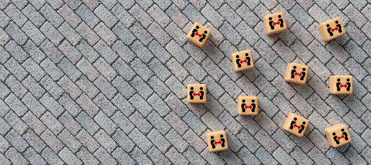 cubes with social distancing icons on stone pavement background