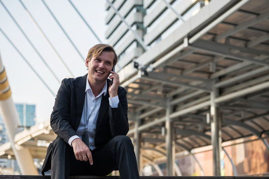 Businessman over phone without people