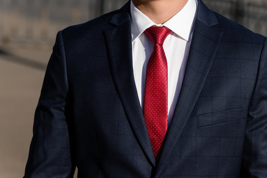 Man in suit. Close up of classic business attire with tie and elegant blazer.