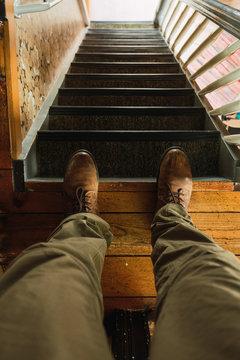 Crop legs on steep staircase