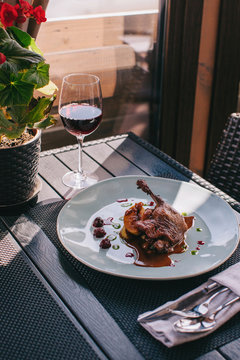 Roast Leg Of Duck served with glass of wine