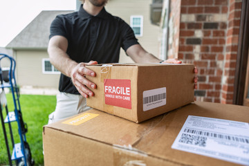 Shipment: Man Drops Off Packages At Door