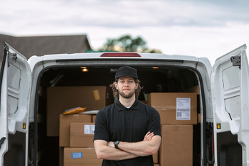 Shipment: Delivery Man Looking At Camera With Arms Crossed
