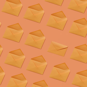 Envelope pattern on a peach color background .
