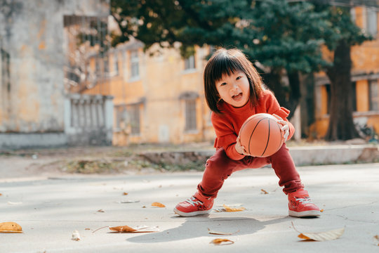 child playing basketball outdoor