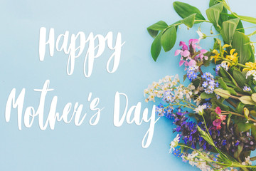 Wall Murals London Happy Mother's day greeting card. Colorful spring flowers border on blue background flat lay with greeting text. Floral greeting card. Happy Mothers day stylish flat lay