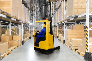 Wall Mural - Huge distribution warehouse with high shelves and forklift with driver.