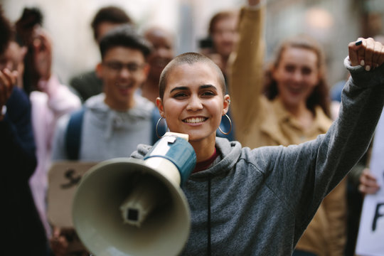 Woman protesting with a megaphone