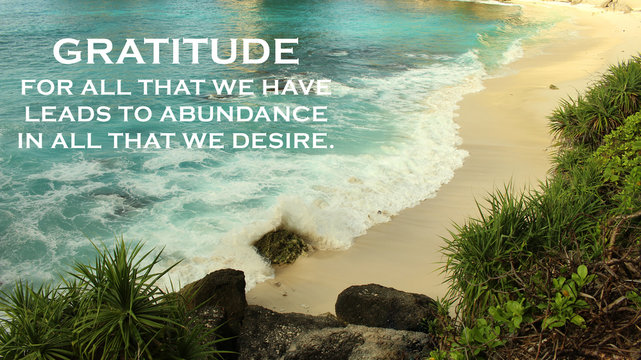 Inspirational quote - Gratitude for all that we have leads to abundance in all that we desire. Gratefulness and happiness concept on background of beautiful beach and sea landscape.