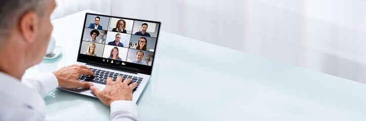 Businessman Videoconferencing With Colleague On Laptop