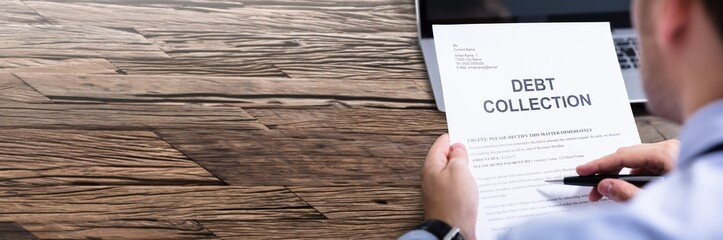Man Reading Debt Collection Letter