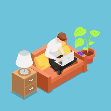 Isometric man with laptop working on sofa at his house