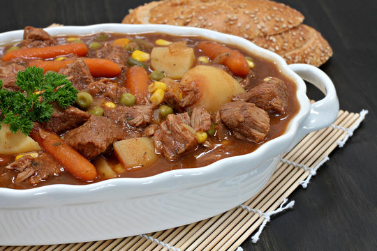 A dish of hearty vegetable beef stew. Macro and partial view.