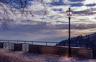 Fotomurales - lamp at sunset in nature valley and snow