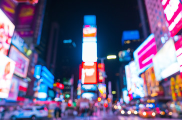 time square at nigh with colorful lighting, -blurred for background.