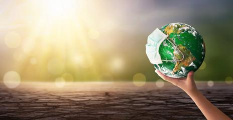 Earth Day Concept: Corona Virus Or COVID 19 Earth Wearing ...