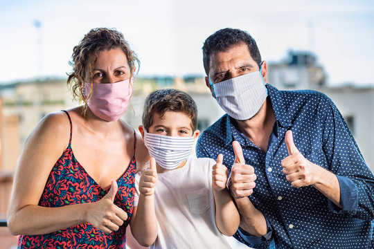 Happy family with protective   masks