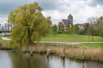 church in the park - view over the river warnow, rostock