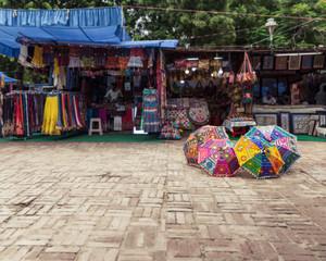 New Delhi, India - August 5, 2018: Shops and umbrellas at Dilli Haat food and handicraft bazar in New Delhi