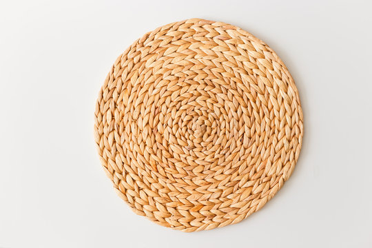Wicker straw stand isolated on white background. Flat lay, top view minimal social media template