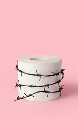 Photo sur cadre textile Ane Toilet paper with barbed wire on color background. Hemorrhoids concept