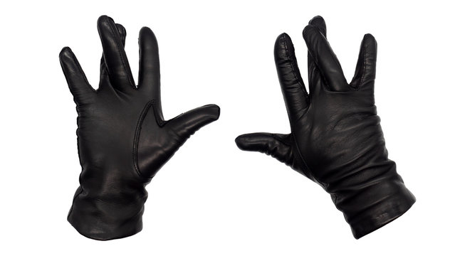 Hands wearing black leather gloves with middle and ring fingers crossed, all other fingers extended.  View from front and back.  Female hand isolated, no skin