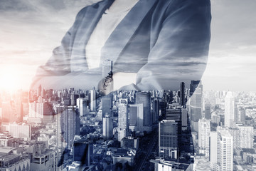 Business Real Estate and Commercial Building Service, Double Exposure Images of Business Woman Standing Arm Crossed With City Background. Business Property Buildings and Financial Estate Investment