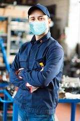 Papiers peints Kiev Young mechanic portrait wearing a mask - coronavirus concept