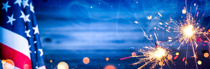American Flag With Sparklers And Smoke On Wooden Background - Independence Day Celebration Concept