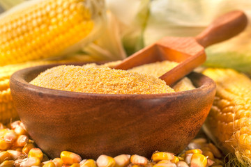 Homemade organically produced corn gritz polenta on a rustic wooden table