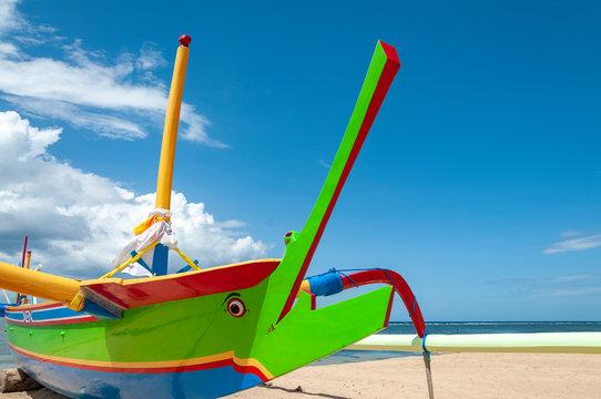 Jukung fishing boats on beach at Sanur Bali Indonesia