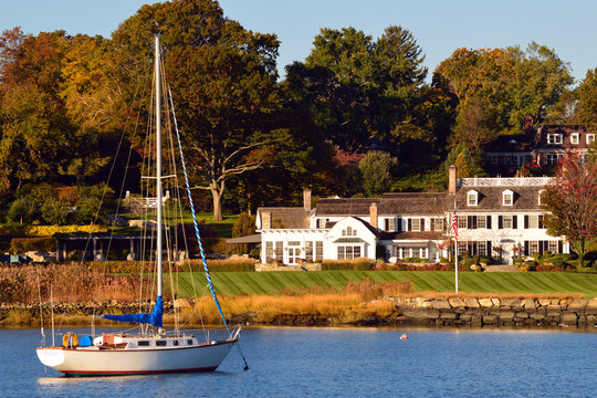 A sailboat is moored at a luxury waterfront homes in Greenwich Connecticut