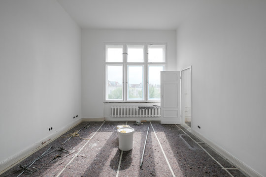 empty  room during renovation with paint bucket