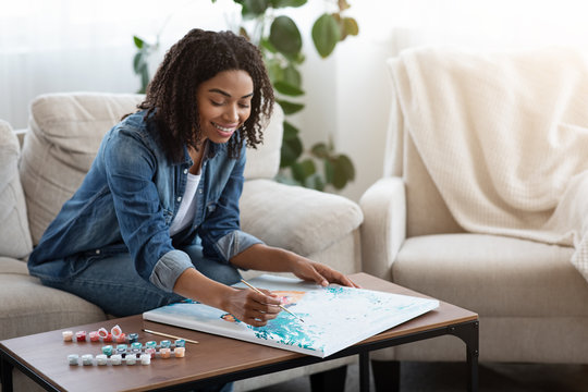 Painting By Numbers. Happy Black Woman Drawing Canvas Picture At Home