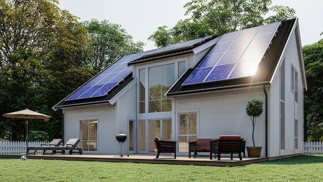 White Scandinavian house with solar panel on black roof