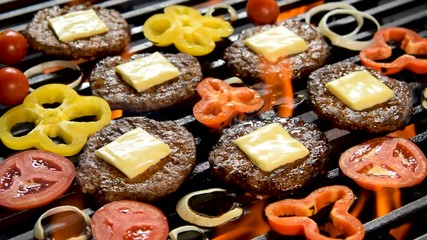 Wall Mural - Grilled meat/burger with vegetable on the flaming grill .