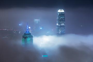 Skyline of Victoria harbor of Hong Kong city in fog Fotomurales