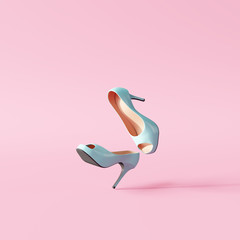 Blue high heels on pastel pink background. minimal concept. 3d rendering
