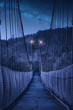 Suspension bridge in Ukraine at night
