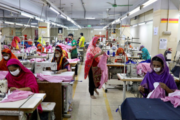 Women work in a garment factory, as factories reopened after the government has eased the restrictions amid concerns over coronavirus disease (COVID-19) outbreak in Dhaka