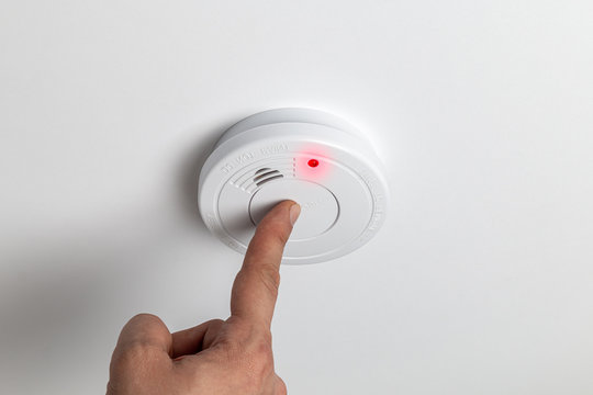 Testing home smoke alarm detector. Stay home safe. Home control and security.  Smoke detector