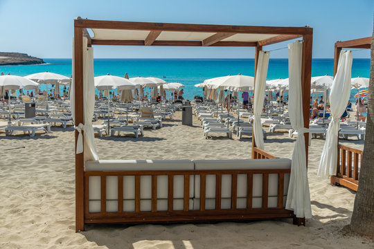 CYPRUS, NISSI BEACH - MAY 12/2018: beach staff prepared massage beds for tourists.