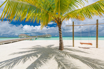 Wall Mural - Over water bungalows on a tropical island with palm trees and amazing vibrant beach. Summer travel and vacation landscape, luxury background. Inspira