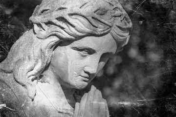 Fotomurales - Retro styled image of Virgin Mary praying in a crown of thorns a symbol of the empathy of the suffering of Jesus Christ. Fragment of antique stone statue.