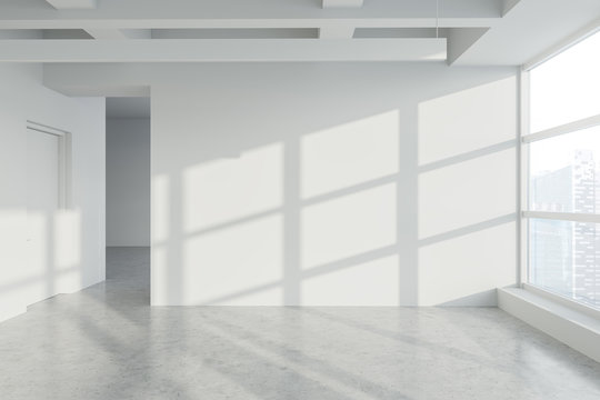 Blank wall in empty white industrial style office